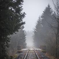 Photograph of mountain railway in foggy day.