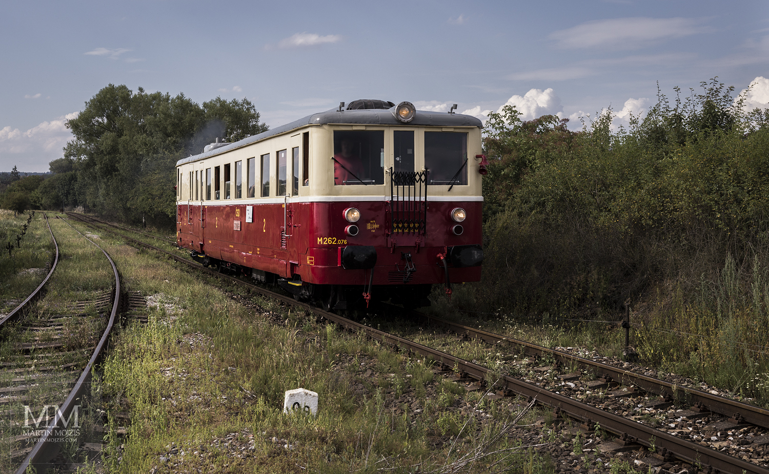Large format, fine art photograph of small yellow and red train. Martin Mojzis.
