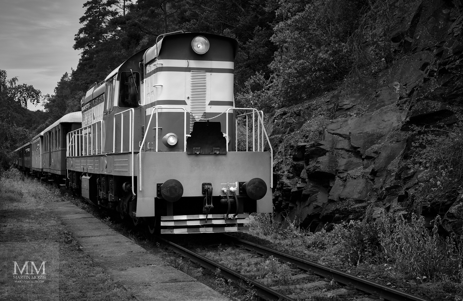 Fine Art black and white photograph of diesel locomotive in head of passenger train. Martin Mojzis.