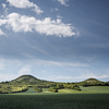 Large format fine art photograph of landscape with small hills and heaven.