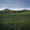 Large format fine art photograph of landscape with small hills.