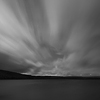 Large format Fine Art photograph of night landscape with flying clouds above lake. Martin Mojzis.