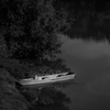 Large format fine art black and white photograph of boat on the river.