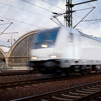 Fast going, motion blurred white locomotive. Professional photography of transport and all infrastructure.